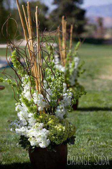 Ceremony decor with Bells of Ireland, Curly Willow, Bamboo and a variety of white and green flowers