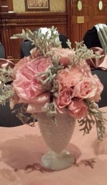 flower arrangement in vintage milk glass