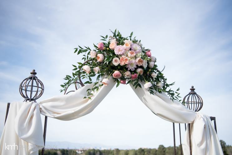 Blush pink wedding arch flowers | bush flowers on a wedding arch