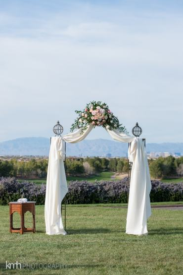 white draped arch with pink flowers | Princess wedding Arch